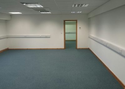 Replacing old worn carpet tiles with new Europa tiles to new help desk centre.