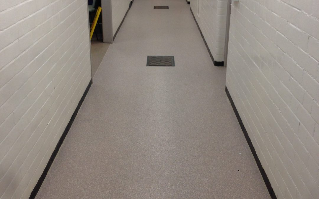 Before and after shots of swimming baths changing room corridor